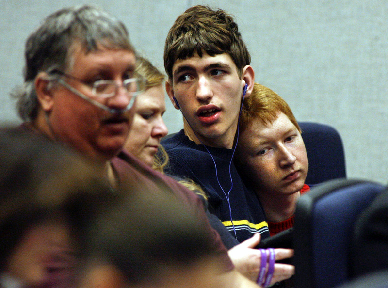 Third from left, Eric Dillard, 15, and Joshua Walters, 16, sit in the gallery during discussion of House Bill 843 - Cannabis at a Criminal Justice Subcommittee meeting in the House Office Building Wednesday, March 5, 2014 in Tallahassee, Fla. The two Pensacola-area teens suffer from Dravet syndrome, a rare form of children's epilepsy which medical marijuana has been used to treat. The Senate will be taking up a related bill called SB 1030 - Medical-grade Marijuana and Cannabis. (AP Photo/Phil Sears)
